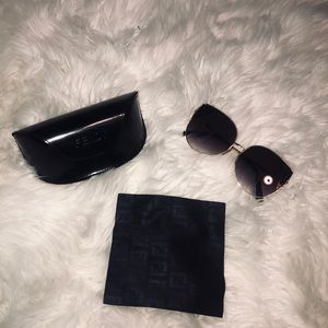 100% authentic Fendi sunglasses and case with wipe